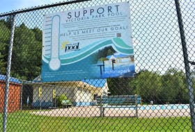 A large sign hangs on the Victoria Park Pool fence, outlining the campaign to help raise funds for the necessary work.
