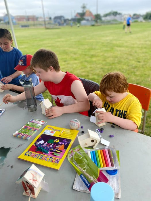 Owen Long, left, and Lucas Tanner work on decorating their birdhouse during a CBRM ADAPT summer camp earlier this month. CONTRIBUTED/CAPE BRETON REGIONAL MUNICIPALITY