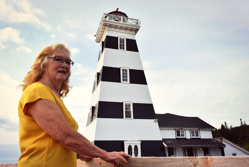 Carol Livingstone admires the iconic West Point Lighthouse in P.E.I., which is one of the most haunted places in Canada.