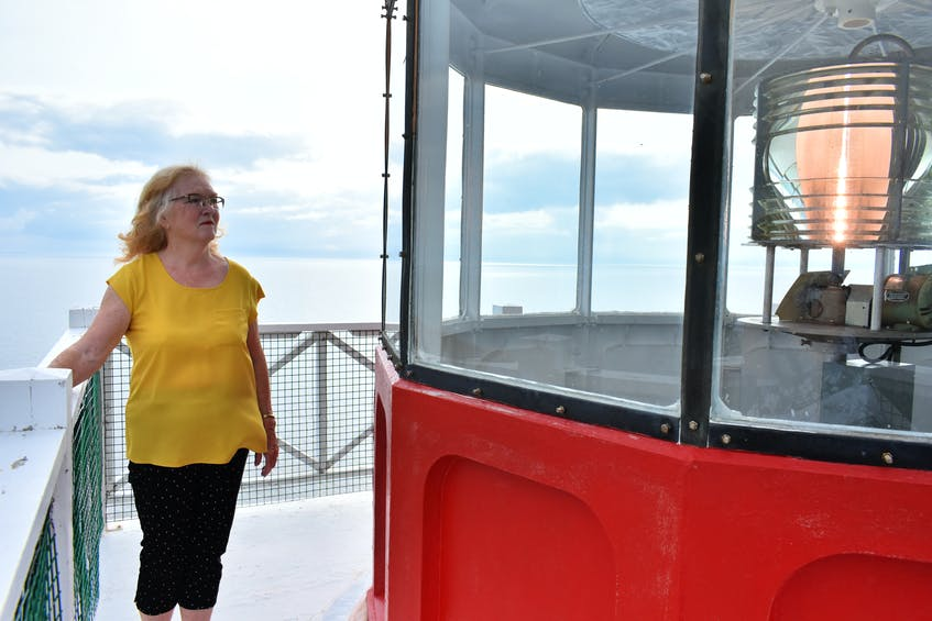 Wind whistles over the balcony overlooking the Northumberland Strait as Carol Livingstone recalls fond childhood memories playing at the West Point Lighthouse where her great-grandfather was the first lightkeeper.