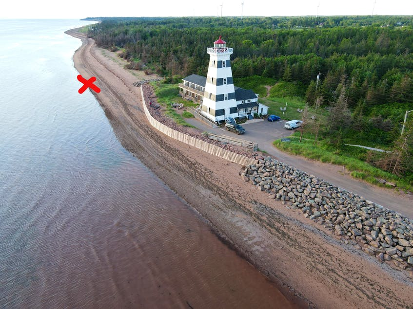 An aerial view where 'X' marks the spot near the lighthouse for buried pirate treasure.