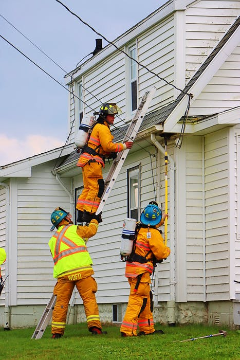 Firefighters Wesley Dueck along with Lieut. Scott Foster and Lieut. Shawn O'Brien inspected a home in Grafton after it was struck by lightning Wednesday afternoon. Adrian Johnstone