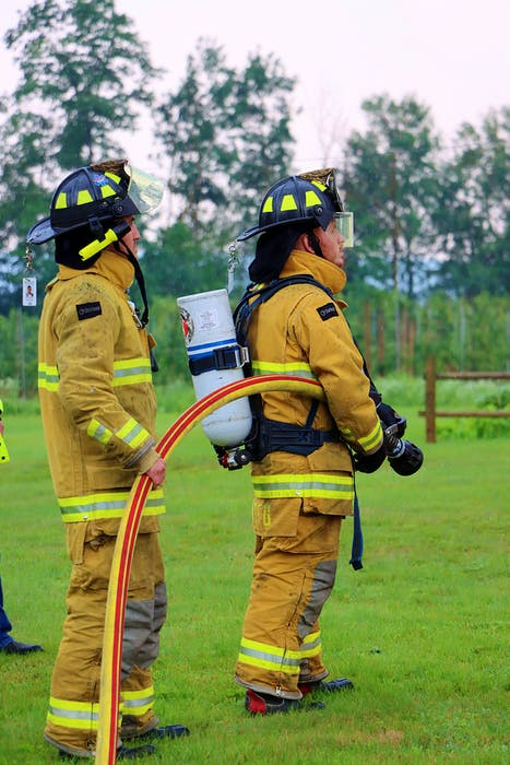 Adam Coleman and Chris Smith were among the firefighters who responded to the lightning strike in Grafton July 21. Adrian Johnstone