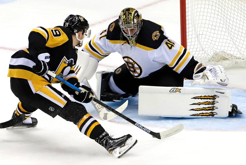 Pittsburgh Penguins' Jared McCann (19) prepares to put a shot around Boston Bruins goaltender Jaroslav Halak (41) in Pittsburgh, Sunday, March 10, 2019