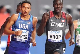 Marco Arop of Canada, right, competes at the 2019 World Athletic Championships in Doha, Qatar.