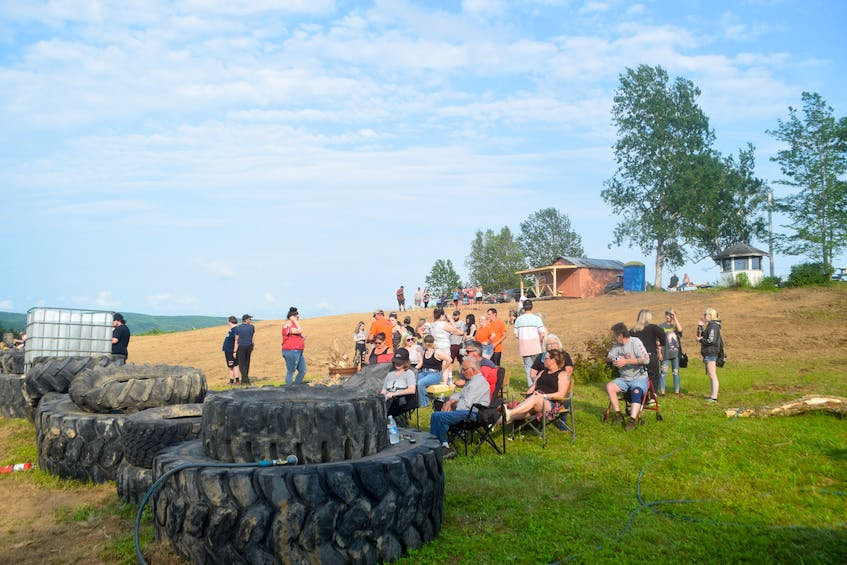 People gathered waiting to watch the first burnout of the night at MacLeod Mountain Mudding