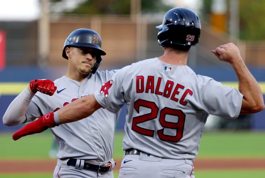 Enrique Hernandez of the Boston Red Sox (left) celebrates his two-run home run with first baseman Bobby Dalbec during the third inning. TIMOTHY T. LUDWIG/USA TODAY SPORTS