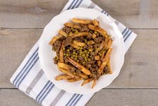 According to local legend, P.E.I.'s iconic hamburger dish - which features hamburger meat, gravy and peas served on top of fries made of locally-grown potatoes - the dish originated at now-shuttered Pat's Takeout in Unionvale, P.E.I., in the mid-1970s.