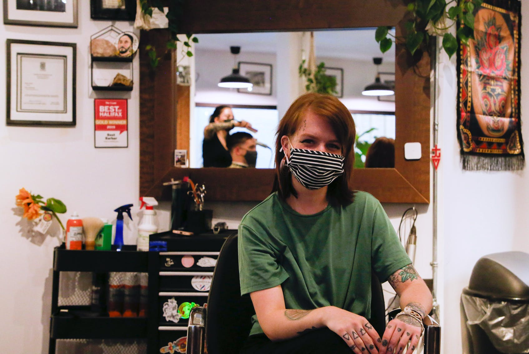 Robyn Ingraham, seen between customer appointments at The Devoted Barbers in Dartmouth on Thursday, says she was asked to drop out of the race for Dartmouth South by the Liberal party. -- TIM KROCHAK PHOTO