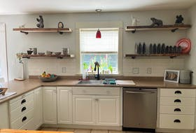 One of the hottest trends right now in home upgrades is giving your kitchen a facelift - for less - by painting kitchen cabinets and swapping out open shelves for older cupboards. Meegan Lovett recently completed a DIY project in her Coldbrook, N.S. kitchen.