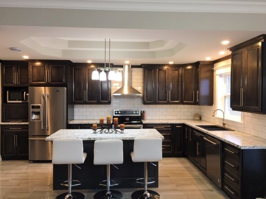 If you're just looking to give your kitchen a facelift, Krista Pippy says it's probably better to refinish your existing cabinets to give your kitchen an updated look. But if you are planning on staying in the home for many years to come, a new kitchen is likely your best bet.