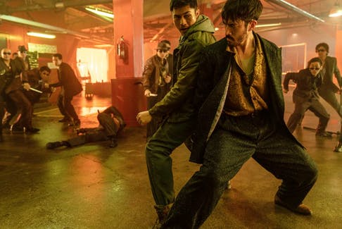 From left, Henry Golding and Andrew Koji fight each other while they have the chance in Snake Eyes.