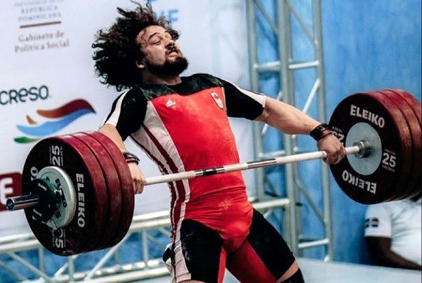 Boady Santavy of Sarnia competes at the Pan American senior weightlifting championships in Santo Domingo, Dominican Republic on April 22, 2021. He won a silver medal and qualified for the Tokyo Olympics. (Contributed Photo) ORG XMIT: POS2104231918015319
