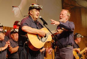 Yogi Muise of the Men of the Deeps, front left, with long-time conductor the late Jack O'Donnell, performs with the choir in Las Vegas in 2008. Muise, noted as the face and voice of the Men of the Deeps, died of cancer on Thursday surrounded by family.