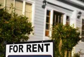 A For Rent sign outside a house.