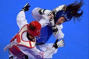 US Anastasija Zolotic (L) and Canada's Skylar Park compete in the Taekwondo Women's Under 57kg Final during the Pan-American Games Lima 2019, in Lima, on July 28, 2019.