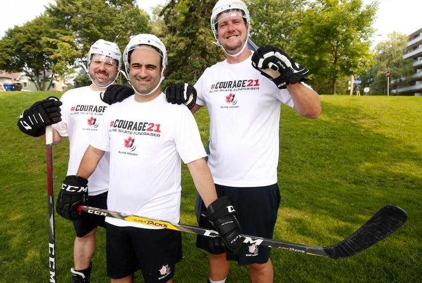 The #Courage21 Windsor to Ottawa Inline Skate Fundraiser to support Blind Hockey Canada takes place September 1. (Pictured L-R) Blind players Matt Shaw and Mark DeMontis pose with Mark Morrow Executive Director of Canadian Blind Hockey