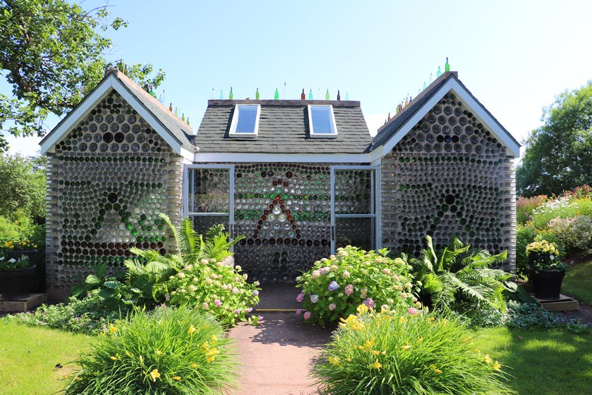 The three life-sized structures – a house, a chapel and a tavern - were made using over 25,000 glass bottles at the Bottle Houses Museum in Cape Egmont. - Helen Earley - Saltwire network