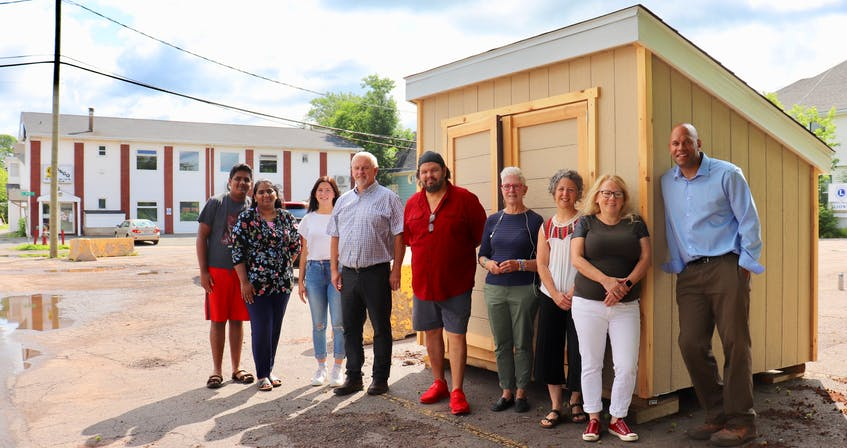 Committee members stand in front of the new P.E.I. Community Fridge in Charlottetown. From left: Samel Sunil, Sandra Sunil, Maria MacLeod, Trevor MacKinnon, John Pritchard, Barb McDowell, Jill Olscamp, Bethany Morrison and Gord McNeily. Not pictured are Sheena Mathew, Ole Hammarlund, Liv Lee and Stephanie O'Regan Rainie, who are also on the committee. - Logan MacLean