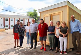 Committee members stand in front of the new P.E.I. Community Fridge in Charlottetown. From left: Samel Sunil, Sandra Sunil, Maria MacLeod, Trevor MacKinnon, John Pritchard, Barb McDowell, Jill Olscamp, Bethany Morrison and Gord McNeily. Not pictured are Sheena Mathew, Ole Hammarlund, Liv Lee and Stephanie O'Regan Rainie, who are also on the committee.