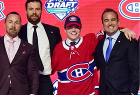 Cole Caufield with, from left, Canadiens assistant GM Trevor Timmins captain Shea Weber and owner Geoff Molson after the team selected Caufield with the No. 15 overall pick at the 2019 NHL Draft at Rogers Arena in Vancouver.