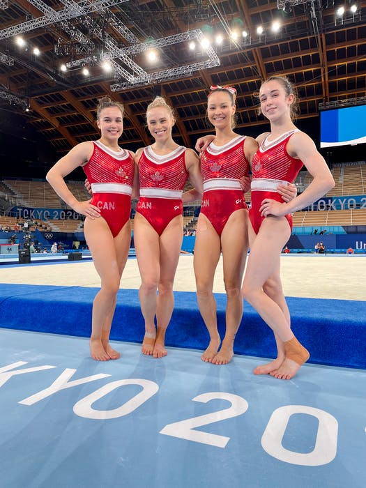 Ellie Black, second from left, and her Canadian teammates Brooklyn Moors, Shallon Olsen and Ava Stewart are shown before their podium training session in Tokyo on Thursday. – Julie Forget