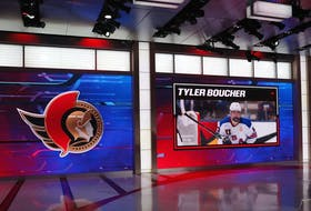 A photo of Tyler Boucher is shown on a screen at NHL Network studios in Secaucus, N.J., on Friday night.