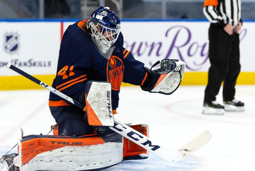 Edmonton Oilers goaltender Mike Smith (41) stops a Winnipeg Jets shot during second period NHL action at Rogers Place in Edmonton, on Saturday, March 20, 2021.