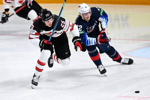 Defenceman Owen Power (left), battling USA forward Tage Thompson for the puck during their  world championship semifinal in Latvia Latvia, last month, was the first overall pick of the Buffalo Sabres in the 2021 NHL draft.