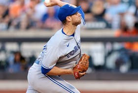 Toronto Blue Jays starting pitcher Steven Matz (22) delivers a pitch against the New York Mets at Citi Field.