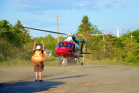 Brooklyn firefighters helped the Life Flight air ambulance crew land and take-off from the Trunk 1 weigh scales in rural Hants County. ADRIAN JOHNSTONE