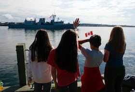 FOR NEWS STORY: Friends and family line the waterfront as they bid bon voyage to HMCS Fredericton as the ship leaves for a 6 month  NATO deployment in the North Atlantic, on Operation Reassurance, in Halifax Saturday July 24, 2021.  TIM KROCHAK PHOTO