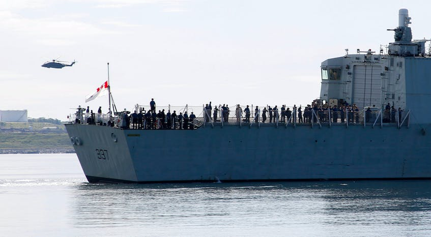 The crew of HMCS Fredericton looks toward family members on shore Saturday morning as the ship leaves on a six-month  NATO deployment in the North Atlantic. -- TIM KROCHAK PHOTO