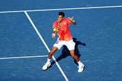 Felix Auger-Aliassime of Team Canada plays a backhand during his Men's Singles First Round match against Max Purcell of Australia on day two of the Tokyo 2020 Olympic Games at Ariake Tennis Park on July 25, 2021 in Tokyo, Japan. (Photo by Clive Brunskill/Getty Images)