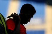 Felix Auger-Aliassime of Team Canada leaves the court after defeat in his Men's Singles First Round match against Max Purcell of Australia on day two of the Tokyo 2020 Olympic Games at Ariake Tennis Park.