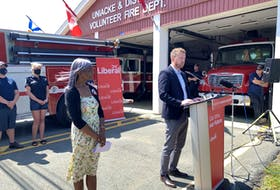 Liberal Leader Iain Rankin announced during a campaign stop in Mount Uniacke on Sunday that fire halls in the province are now eligible for federal funding for infrastructure repairs. At left is Sackville-Uniacke Liberal candidate Donalda MacIsaac.