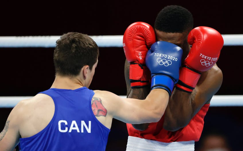 Canada's  Wyatt Sanford  lands a punch square on the face of  Merven Clair of Mauritius during preliminary action in the men's welterweight class at the Tokyo Olympics on Saturday. Sanford, of Kennetcook, lost 5-0 to Clair. REUTERS/Ueslei Marcelino