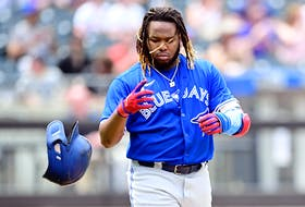 Vladimir Guerrero Jr. of the Toronto Blue Jays tosses his helmet after flying out against the New York Mets during the third inning at Citi Field on July 25, 2021 in the Queens borough of New York City.