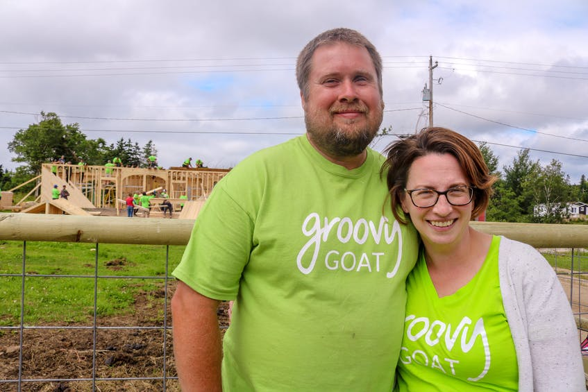 Groovy Goat owners Ryan and Shannon Costelo in front of the volunteers helping rebuild their barn, on Saturday afternoon in Ingonish, N.S. JESSICA SMITH/CAPE BRETON POST