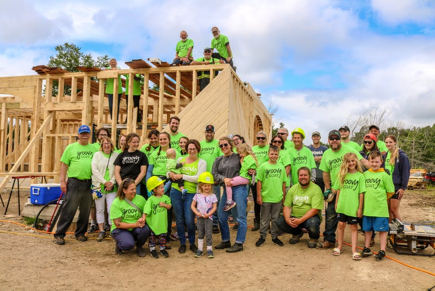 Volunteers gather at the site of the new barn being rebuilt for the Groovy Goat Farm & Soap Company in Ingonish on Saturday afternoon. JESSICA SMITH/CAPE BRETON POST
