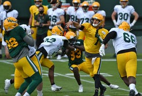Edmonton Elks quarterback Trevor Harris throws a pass during the team's lone scrimmage of training camp at Commonwealth Stadium in Edmonton on Sunday, July 25, 2021.