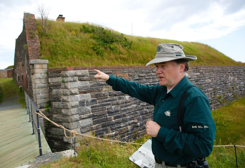 Hal Thompson, visitor experience and product development officer with Parks Canada, explains some historical details at the entrance to Fort Charlotte on Georges Island National Historic Site. - Tim Krochak