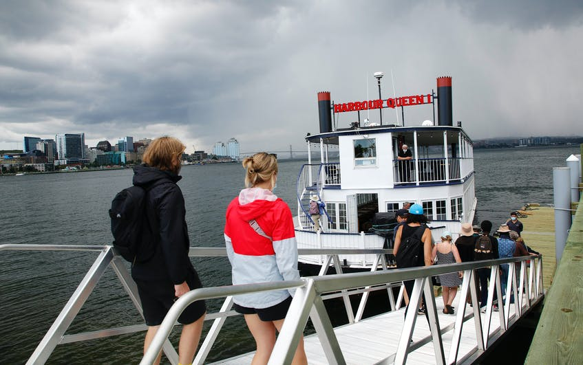Visitors board the Harbour Queen following a tour of Georges Island National Historic Site on Friday. - Tim Krochak