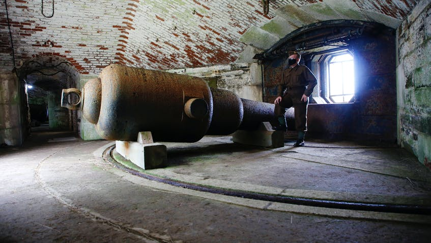 Gunner Bryce Walsh talks about one of the four rifle muzzle loaded guns, which was fed 10-inch shots, that still stand silent sentry on Georges Island National Historic Site. - Tim Krochak