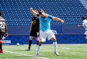 Alessandro Riggi celebrates a goal by HFX Wanderers  teammate Pierre Lamothe during a CPL win over Valour FC in Winnipeg on Saturday. - Canadian Premier League