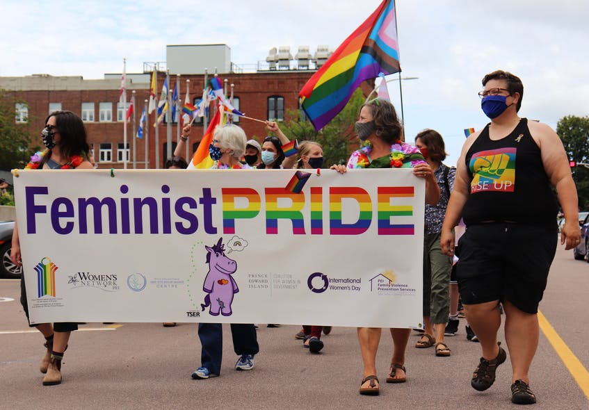 Several community organizations joined the Pride P.E.I. march on July 24, including the women's rights organizations pictured here, PEERS Alliance and the P.E.I. Transgender Network. - Logan MacLean
