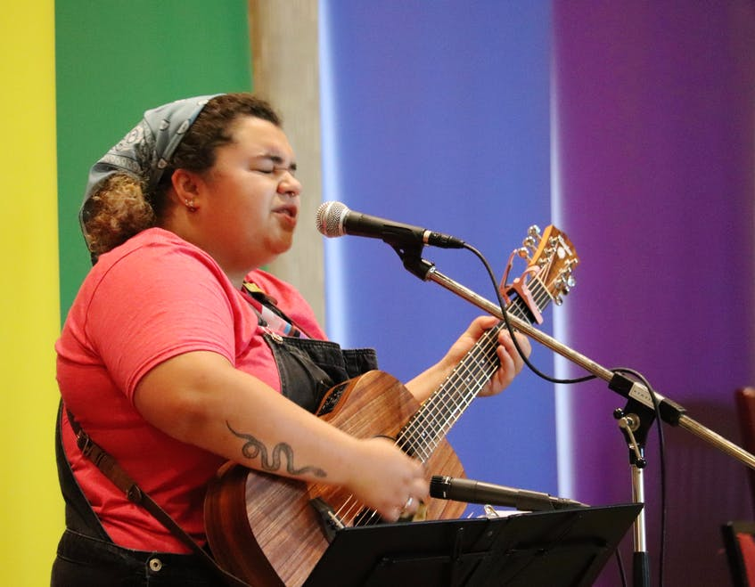 Singer-songwriter Joce Reyome, who is also on the Pride P.E.I. board of directors, performs at the Pride in the Park concert on July 24. It was moved inside to the Delta Prince Edward after rain the week before left the original location unusable. - Logan MacLean