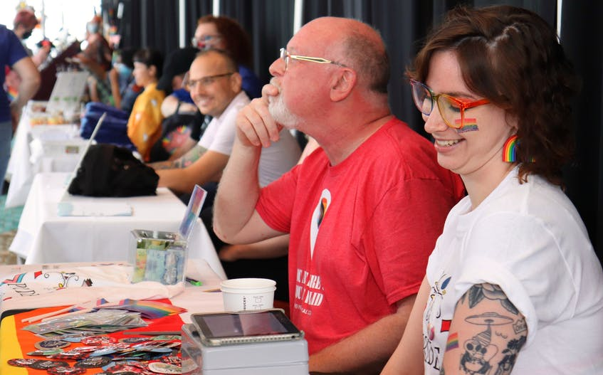 Pride P.E.I. vice-chair Dave Stewart, left, and board director Rachel Adams chat with guests at the Pride Market Expo, where they were also selling Pride Festival T-shirts. The expo took place at the Delta Prince Edward in Charlottetown. - Logan MacLean