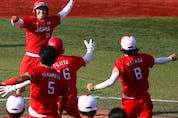 Japan won it with a bases-loaded single from Eri Yamada in the bottom of the eighth, the extra inning. Yamada revealed at her post-game news conference that her father died just on Saturday.