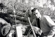 Johnny Cash with his moose at Victoria Lake, Newfoundland, Oct. 11, 1961. Photo by Richard Friske.